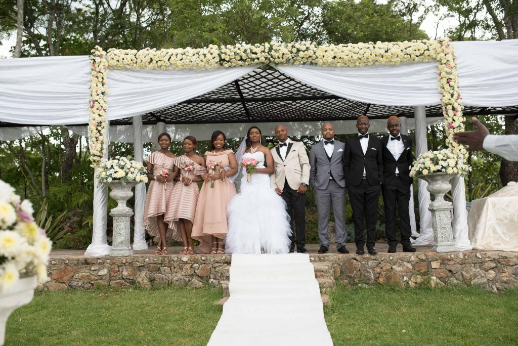 Raphael Kangai and Kundai Kangai stand with their Bridal team after their wedding ceremony - Wedding Expos Africa