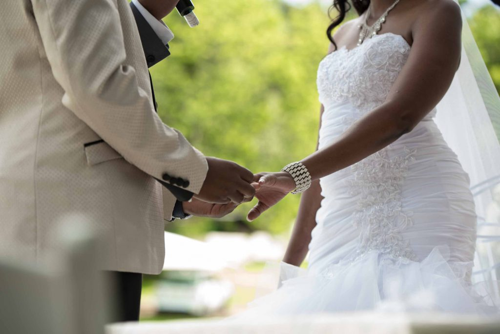Raphael Kangai puts the wedding ring on Kundai's finger - Wedding Expos Africa