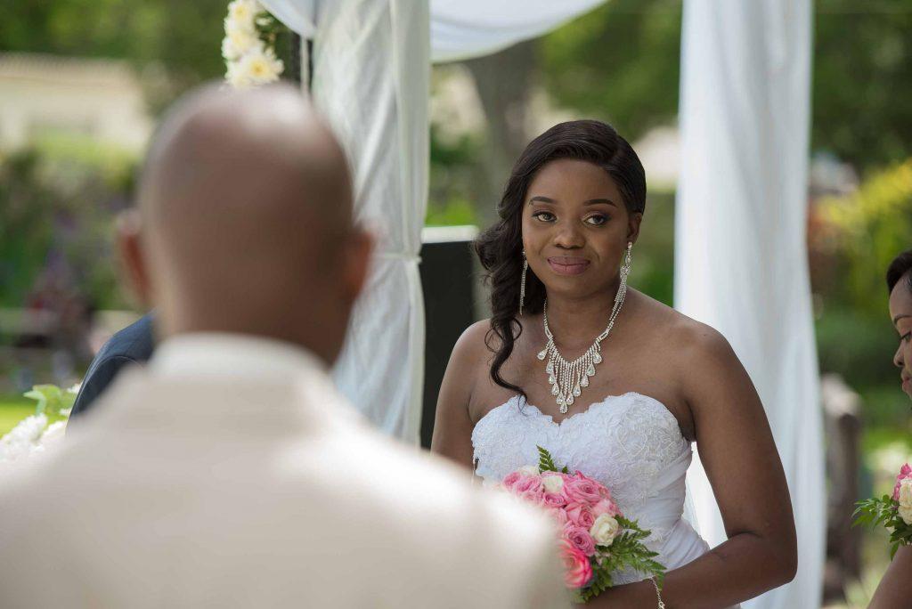 Kundai looks at Ralph Kangai on their wedding day - Wedding Expos Africa