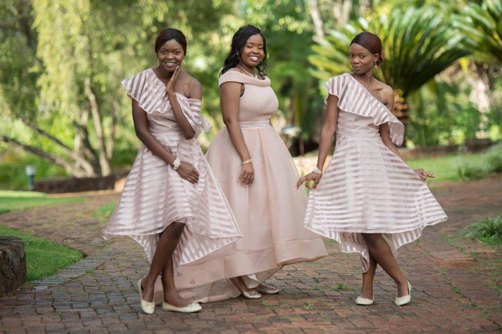 beautiful bridesmaids dresses - kundai mendissa dube and ralph kangai wedding - Real Zimbabwe weddings photos - African Weddings on Wedding Expos Africa