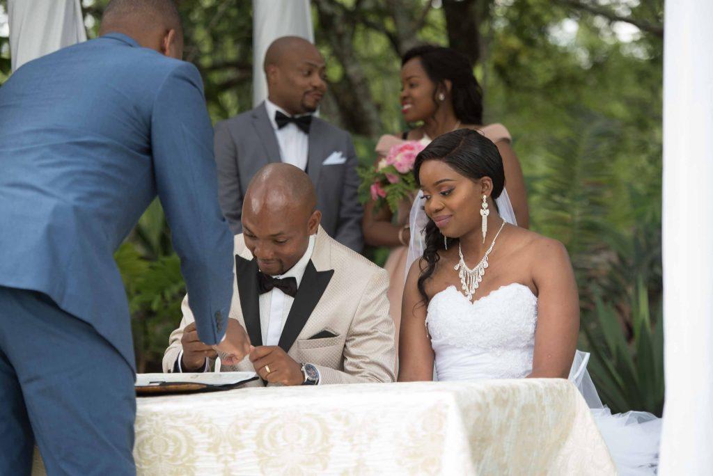 Kundai and Ralph sign the certificates - Wedding Expos Africa