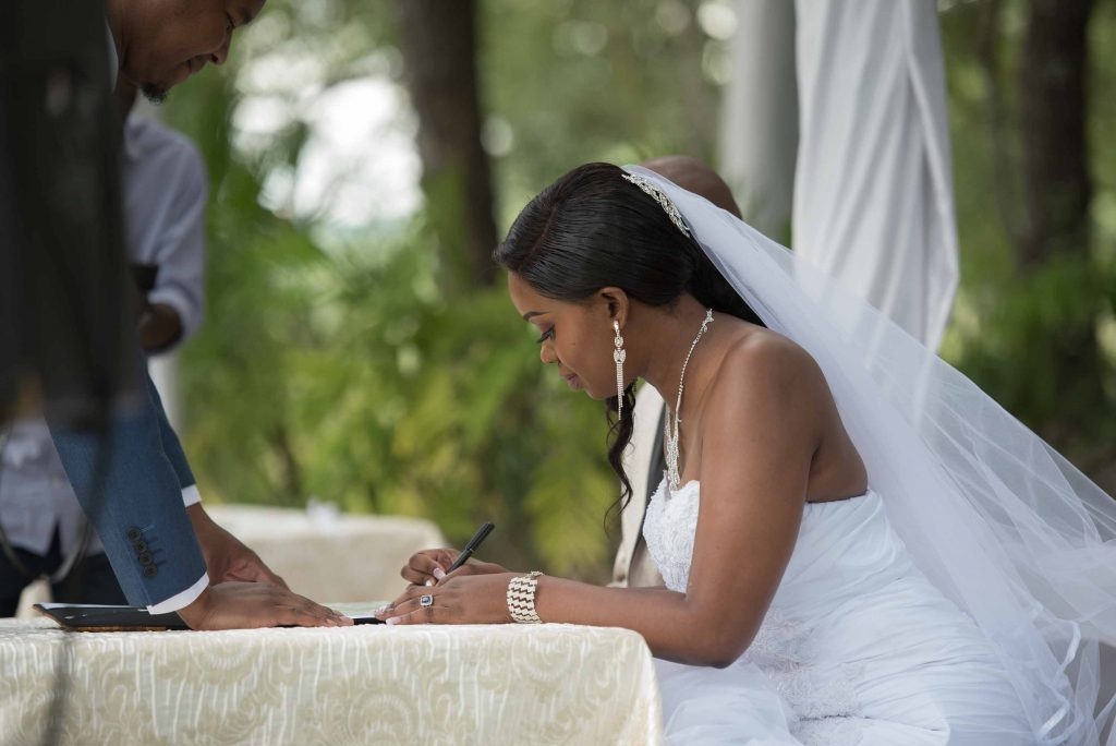Signing of certificates - kundai mendissa dube and ralph kangai wedding - Real Zimbabwe weddings photos - African Weddings on Wedding Expos Africa