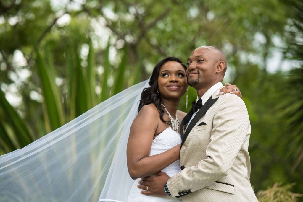 Bride and groom pose for wedding photos - kundai mendissa dube and ralph kangai wedding - Real Zimbabwe weddings photos - African Weddings on Wedding Expos Africa - Ernest Mackina Photography