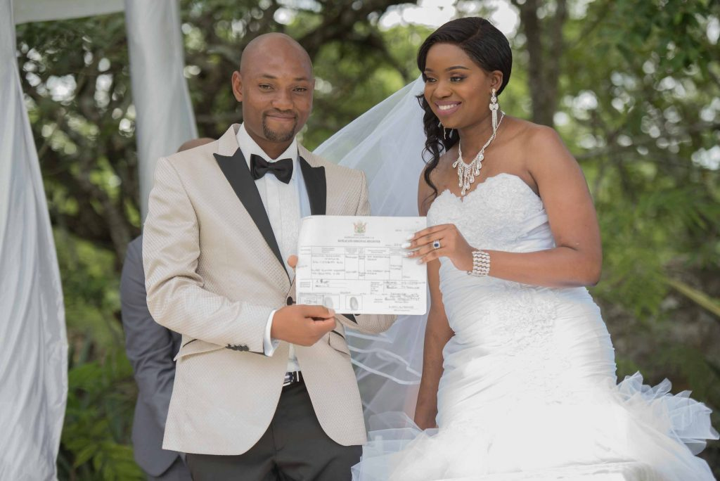 Mr and Mrs Kangai show off their marriage certificate