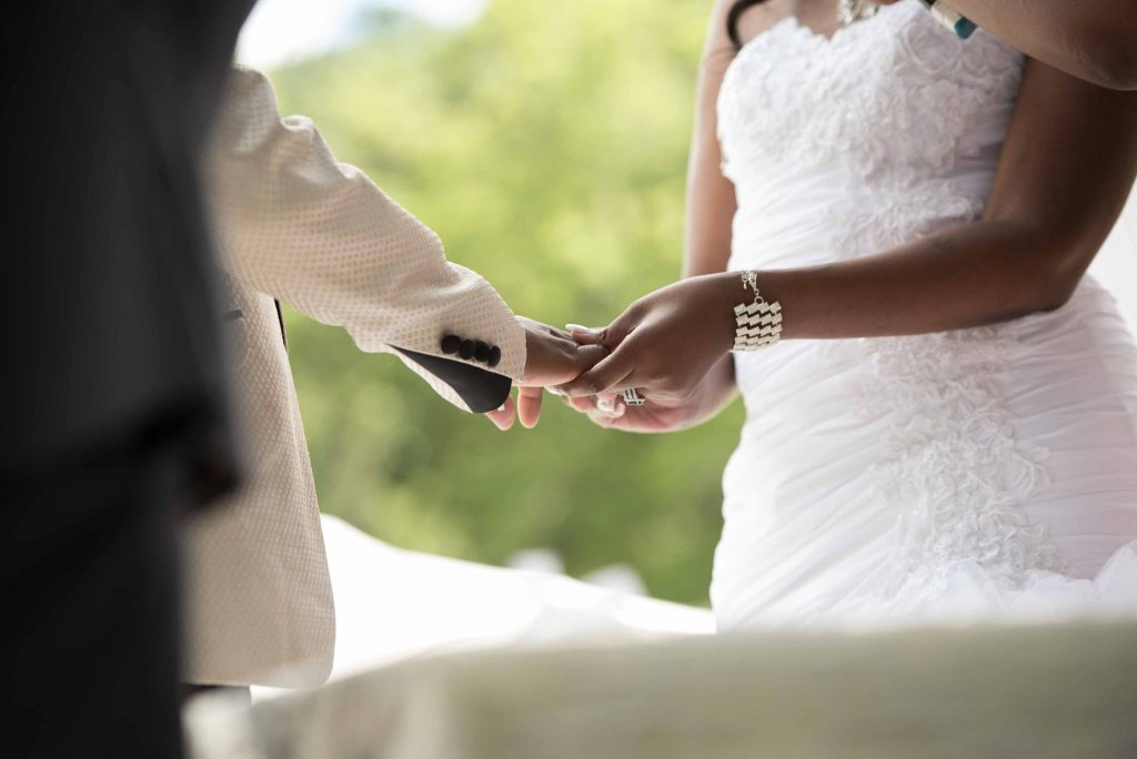 Kundai Mendissa Dube and Ralph Kangai exchange wedding rings during the ceremony - Real Zimbabwe Weddings