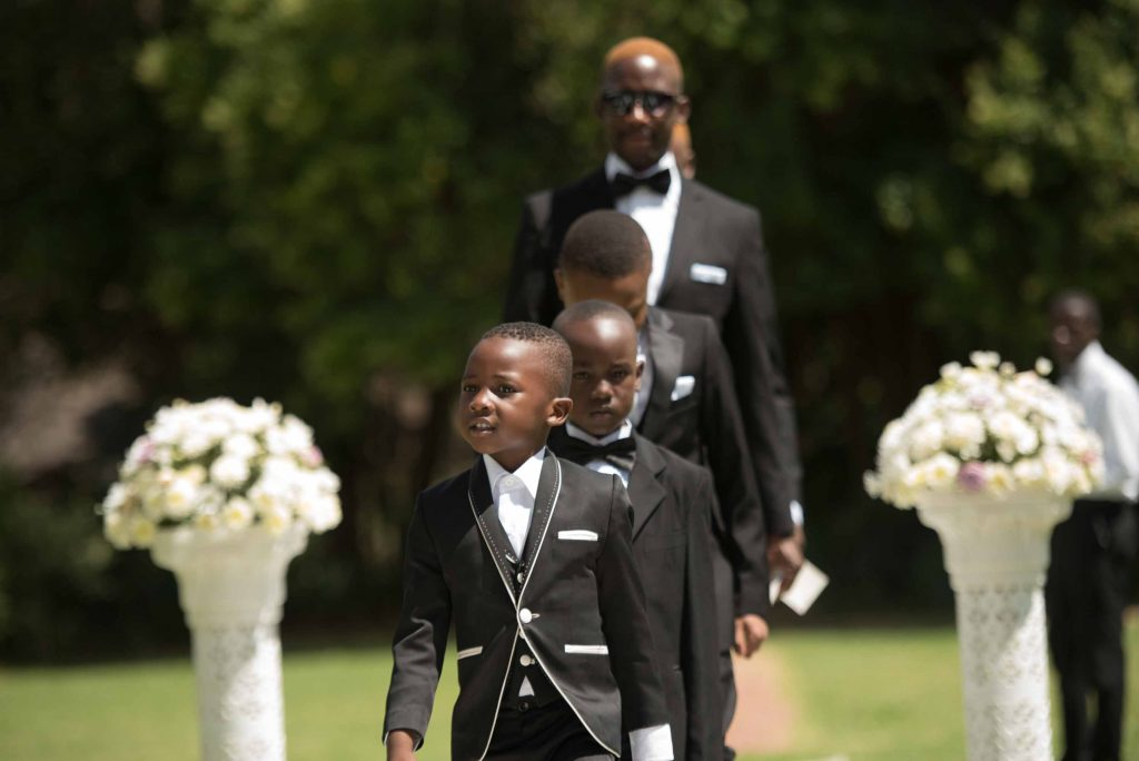 Mini grooms men walk down the aisle - kundai mendissa dube and ralph kangai wedding - Real Zimbabwe weddings photos - African Weddings on Wedding Expos Africa